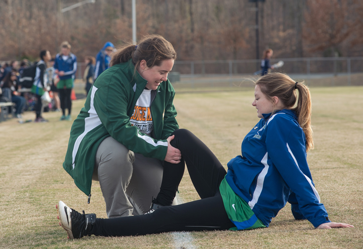 Jeane Ryder, athletic trainer and Mason graduate student, works with Forest Park High School student athletes.