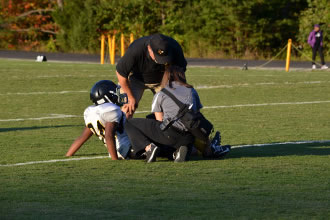 Helping an injured football player