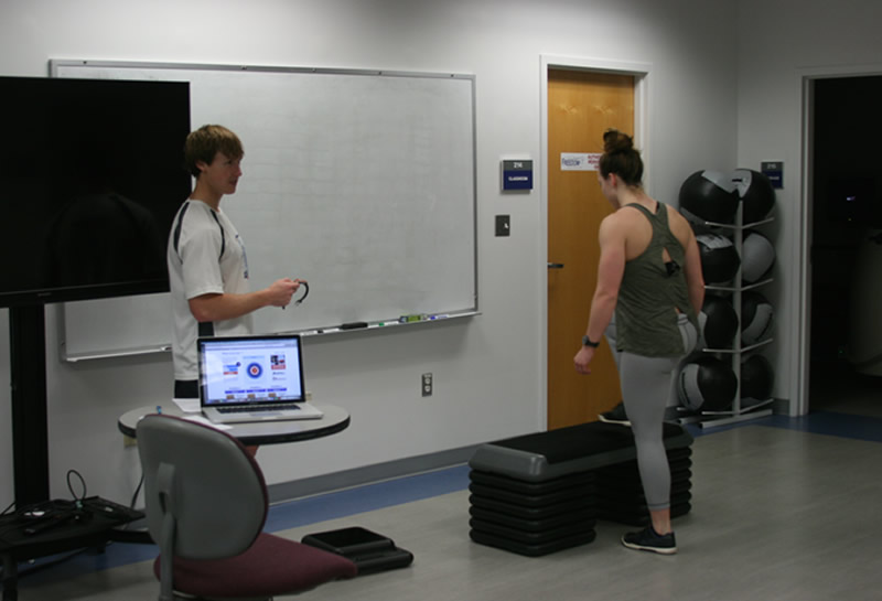 Kinesiology major students collecting data during a lab in Exercise Prescription and Programming